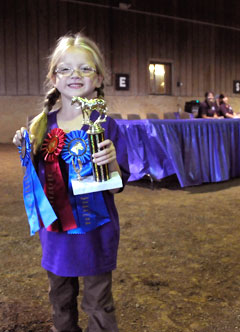 Girl with Trophy at Horse Show